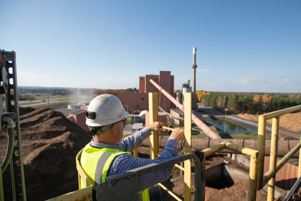Employee Scaling Facility Ladder at ReEnergy Black River