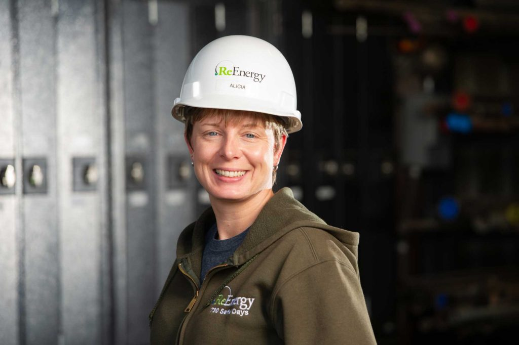 Smiling Employee with Hard Hat at ReEnergy Black River
