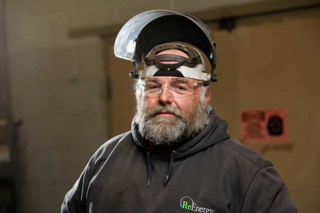 ReEnergy Stratton Employee with Protective Face Shield
